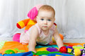 Blue eyes cute baby playing with toys Stock Images
