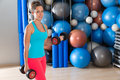 Blue eyes girl at gym weightlifting dumbbells Royalty Free Stock Photo