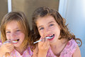 Blue eyes kids sister girl eating breakfast Royalty Free Stock Photo