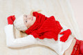 Blue eyes young woman wearing red knitted beautiful happy smiling blond gloves and shawl looking at camera Stock Image