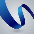 Blue fabric curved ribbon on grey background Royalty Free Stock Photo