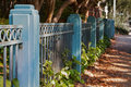 Blue Fence sidewalk Royalty Free Stock Photos