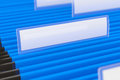 Blue file folders hanging folder with blank tag on it Stock Photography
