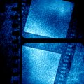 Blue filmstrip grunge with some spots and stains on it Stock Photos