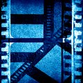 Blue filmstrip grunge with some spots and stains on it Stock Images