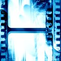 Blue filmstrip grunge with some spots and stains on it Stock Photo