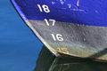 Blue fishing boat reflecting in the water bow of a fishingboat Royalty Free Stock Photos
