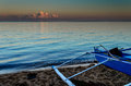 Blue Fishing Boat At Sunset