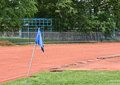 Blue flag on the corner  of running tracks. Royalty Free Stock Photo