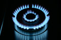 Blue flame of gas stove in the dark Royalty Free Stock Image