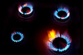 Blue flames of a burning natural gas on stove in the kitchen Royalty Free Stock Image