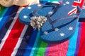 Blue flip flops on beach towel with sea shells Stock Photos