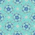 Blue Floral Mandala with a Turquoise Background