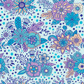 Blue floral ornamental seamless pattern. Vector decorative background. Flowers and herbs doodle elements