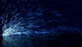 Blue flowing sparks tone background of defocused lights and Royalty Free Stock Image