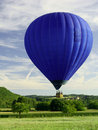 Blue flying hot air balloon Royalty Free Stock Photography