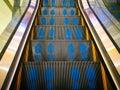 Blue footprints mark on escalator stair. Royalty Free Stock Photo