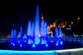 Blue fountain mosque night water display in downtown istanbul with a in the background Royalty Free Stock Images