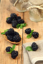 Blue fruit sweet blackberry on wooden table Stock Photos