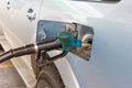 Blue fuel connecting to the car add fuel Royalty Free Stock Photo