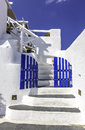 Blue gates with white stairs beautiful details of santorini island as welcome sign greece Royalty Free Stock Photos