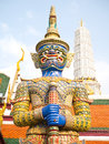 The blue giant demon statue in historic thai art style at temple of emerald buddha Stock Photos