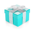 Blue gift box with silver ribbon and bow Royalty Free Stock Photo