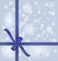 Blue gift ribbon wrapped around blurred winter background Royalty Free Stock Photography