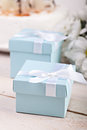 Blue giftbox on festive table Royalty Free Stock Image