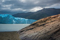 Blue glacier in the background of the mountains near the bay. Shevelev. Royalty Free Stock Photo