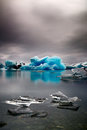 Blue glacier ice melting iceland global warming iceberg landscape at joulsarlon lagoon drifting pack due to caused by beautiful Royalty Free Stock Image
