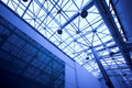 Blue glass ceiling in office Stock Image
