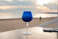Blue glass closeup on romantic sunset beach Royalty Free Stock Photo