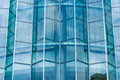 Blue glass wall of skyscraper the Stock Image