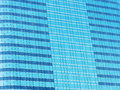 Blue glass wall of skyscraper, abstract background. Royalty Free Stock Photo