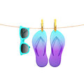 Blue glasses and flip flops hanging on rope with clothespins, isolated on white, summer background Royalty Free Stock Photo