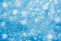 Blue glitter sparkles snow flakes background