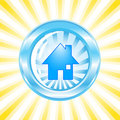 Blue glossy icon with a house on it Royalty Free Stock Photo