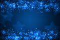 Blue glowing bokeh holiday background star Stock Images