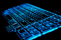 Blue glowing computer laptop keyboard Royalty Free Stock Photo