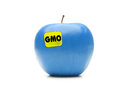 Blue gmo apple with yellow label shot on white Royalty Free Stock Photos