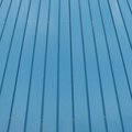 Blue goffered metal texture, corrugated steel surface Royalty Free Stock Photo