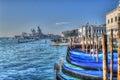 Blue gondolas in venice shoreline italy Stock Image