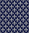 Blue and gray fleur de lis textured fabric background that is seamless repeats Royalty Free Stock Image