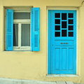 Blue greek shutters window and door in old house Royalty Free Stock Photo