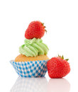 Blue and green cupcake with strawberries Royalty Free Stock Photo