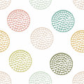 Small circles in green and blue colors on the white background.
