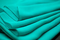 Blue, green, marine silk tender colored textile, elegance rippled material Royalty Free Stock Photo