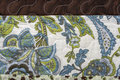 Blue and green paisley brown satin border with floral textile detail closeup Royalty Free Stock Photography