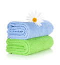 Blue and green towels and camomile flower Royalty Free Stock Photography